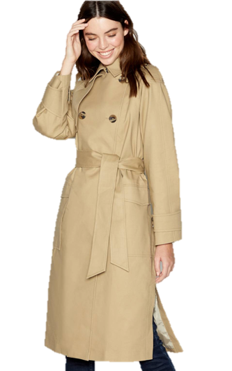 A person standing in front of a coat Description automatically generated