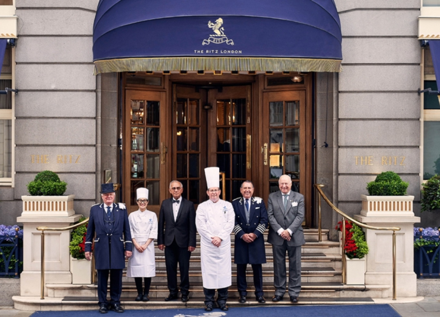 An image of staff stood outside The Ritz hotel, London.