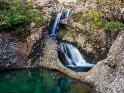 The Fairy Pools image is from a birds eye view looking down on the waterfall and greenery around the area.