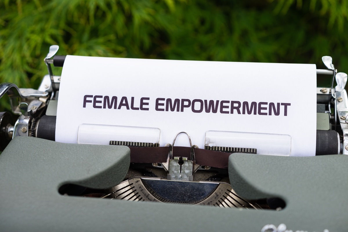 This image shows a typewriter, the paper that is coming out of the machine says 'Female Empowerment'.