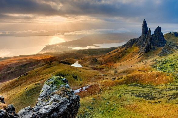 This image is a landscape photo of the Isle of Skye, Scotland, specifically The Old Man of Storr.