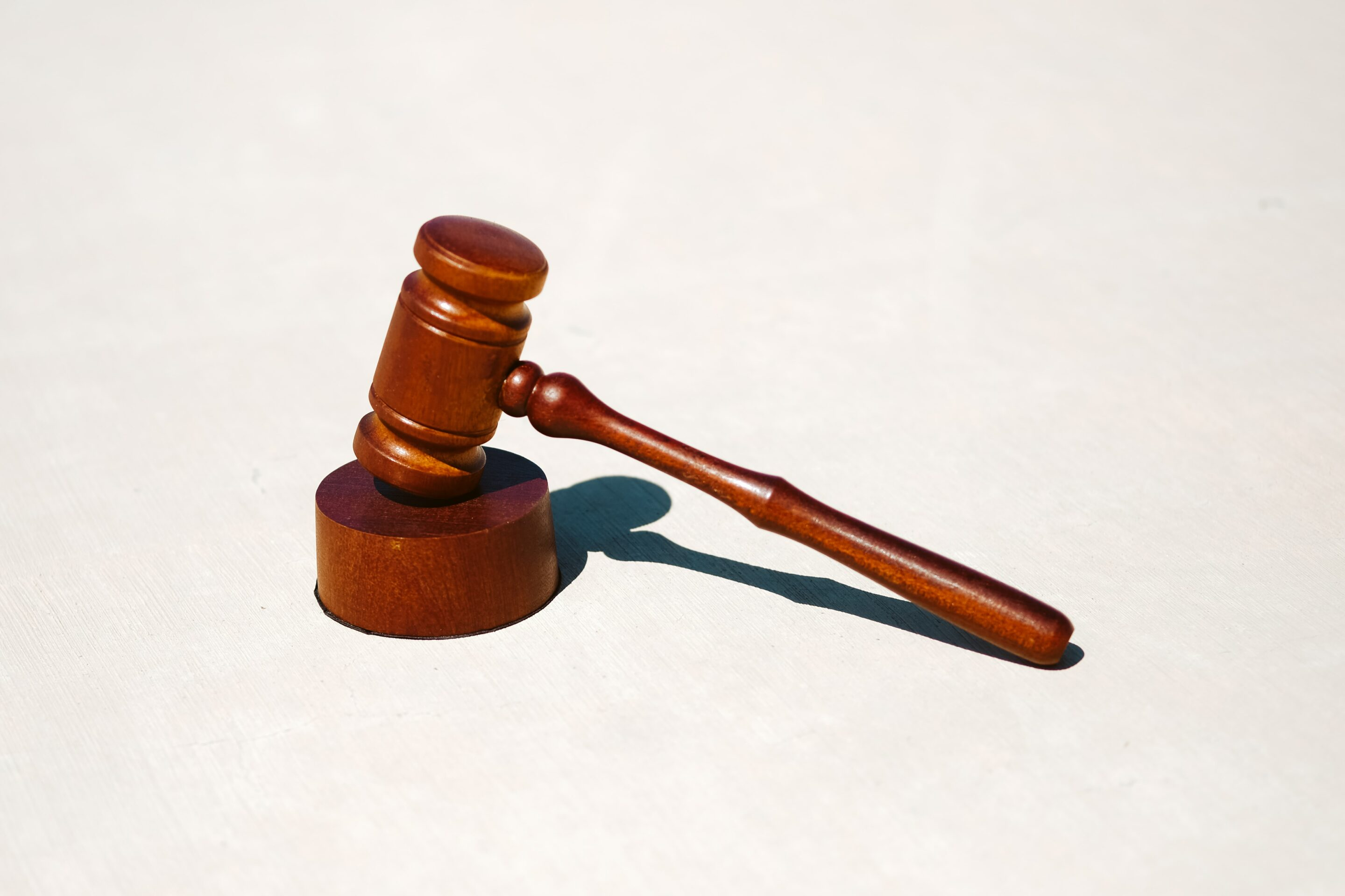 This image shows a wooden hammer that would be used in a court case.