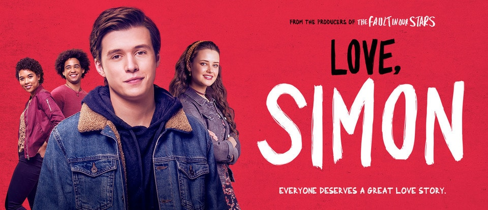 A promotional banner for Love, Simon. The title is written in bold black and white font on the right of the banner. Simon, the main character, features on the left of the banner. Over his left shoulder is one if his best friends who is smiling. Over his right shoulder is another two of his close friends, both smiling.
