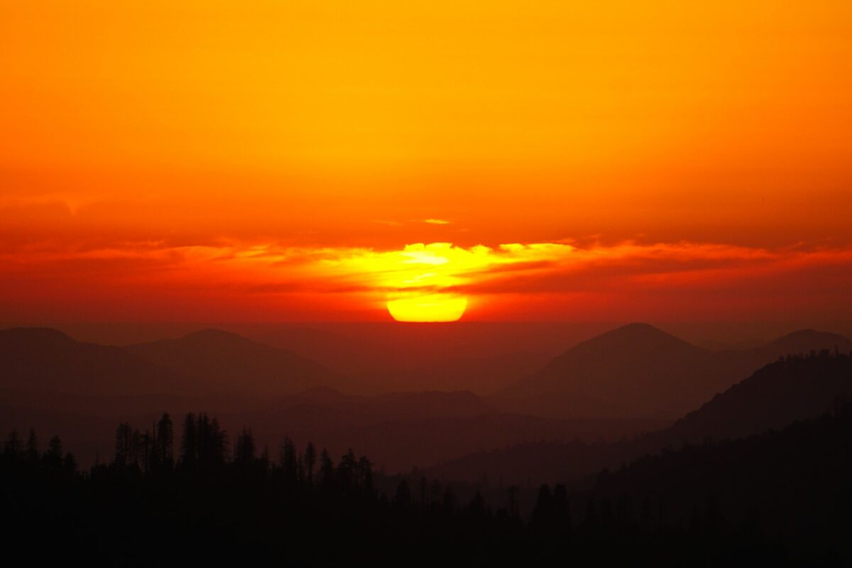 This sunset image is deeply orange toned with a gradient getting darker as we go down, resembling the Lion King sunset.