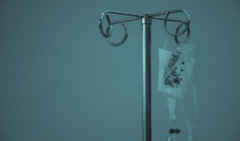This image is very blue toned and medical looking with the medical drip in the picture hanging.
