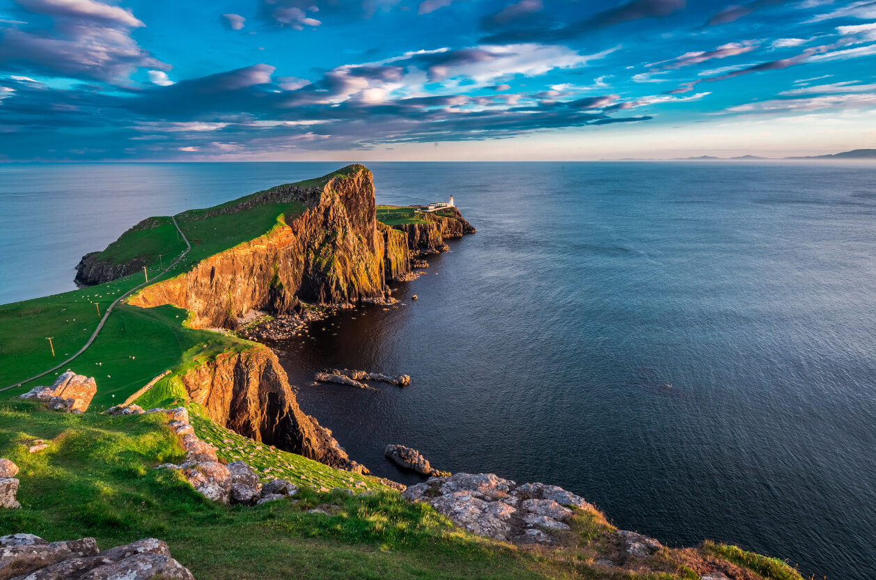 This blue sunset shines through at the Neist Point. The land seems tranquil and peaceful