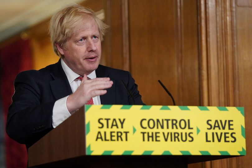 This image shows Boris talking in a covid announcement with the reading visible saying 'stay alert, control the virus, save lives'
