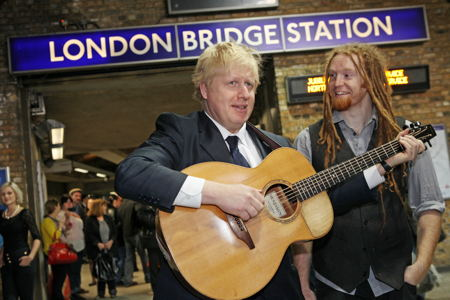 Boris is seen in this photo holding a buskers guitar at a London underground tube station.