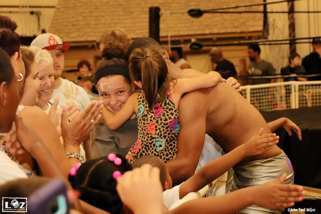 This image shows JT Funk hugging his family after a fight.
