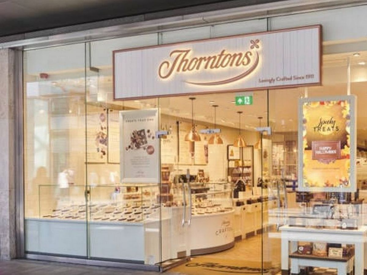 Thorntons is pictured here with large glass windows and warm lighting.