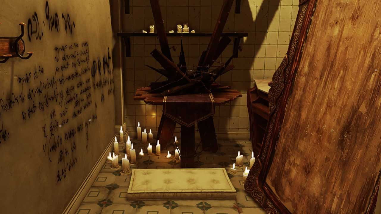 There is a small room that has graffiti on the left wall. There are candles on the floor towards the back of the wall and above those candles is a shrine. This is a shrine where players can get bone charms.