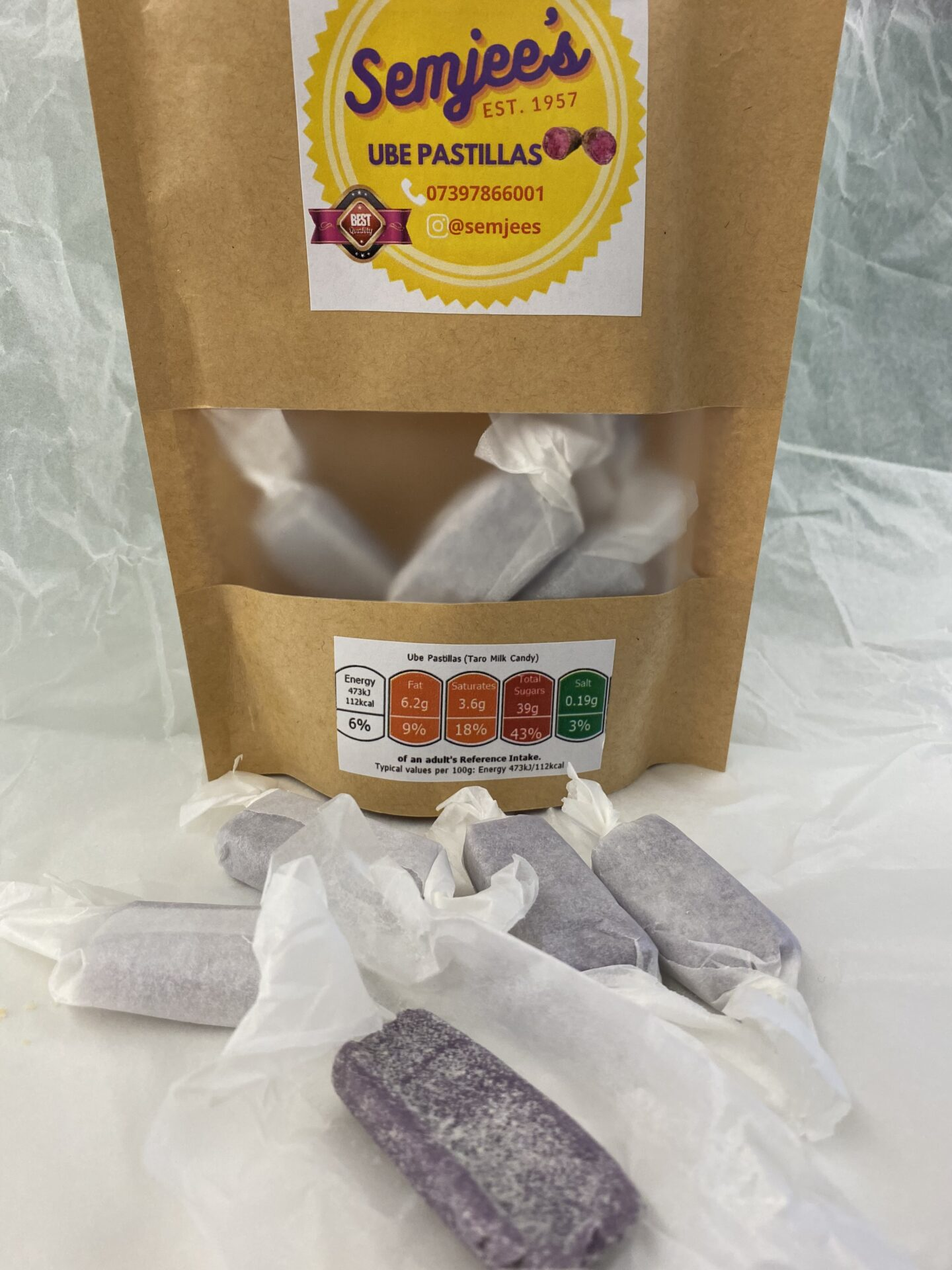 Semjees Ube Pastillas are pictured here with a few out of the packaging and one unwrapped.