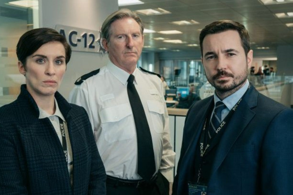 This image shows Line of Duty cast in their costumes for AC-12. In the image is Ted Hastings, Steve Arnott and Kate Fleming.