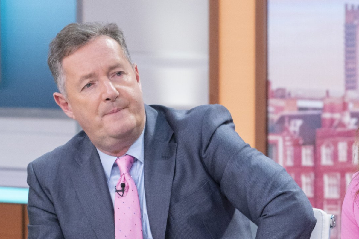 Piers Morgan is pictured here with a pink tie on as he leans to a side during a GMB show.