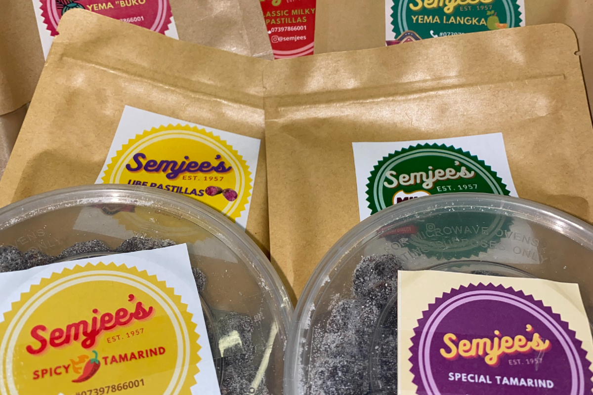 A box of classic Filipino sweets gifted by Semjee's containing 5 bags and 2 tubs of sweets.