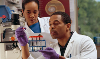 This image shows two scientists in a lab.