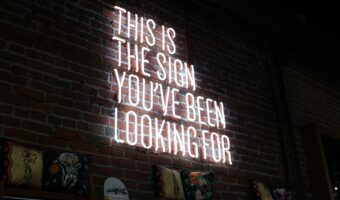 This image shows a LED sign reading 'this sign is the sign you've been looking for'