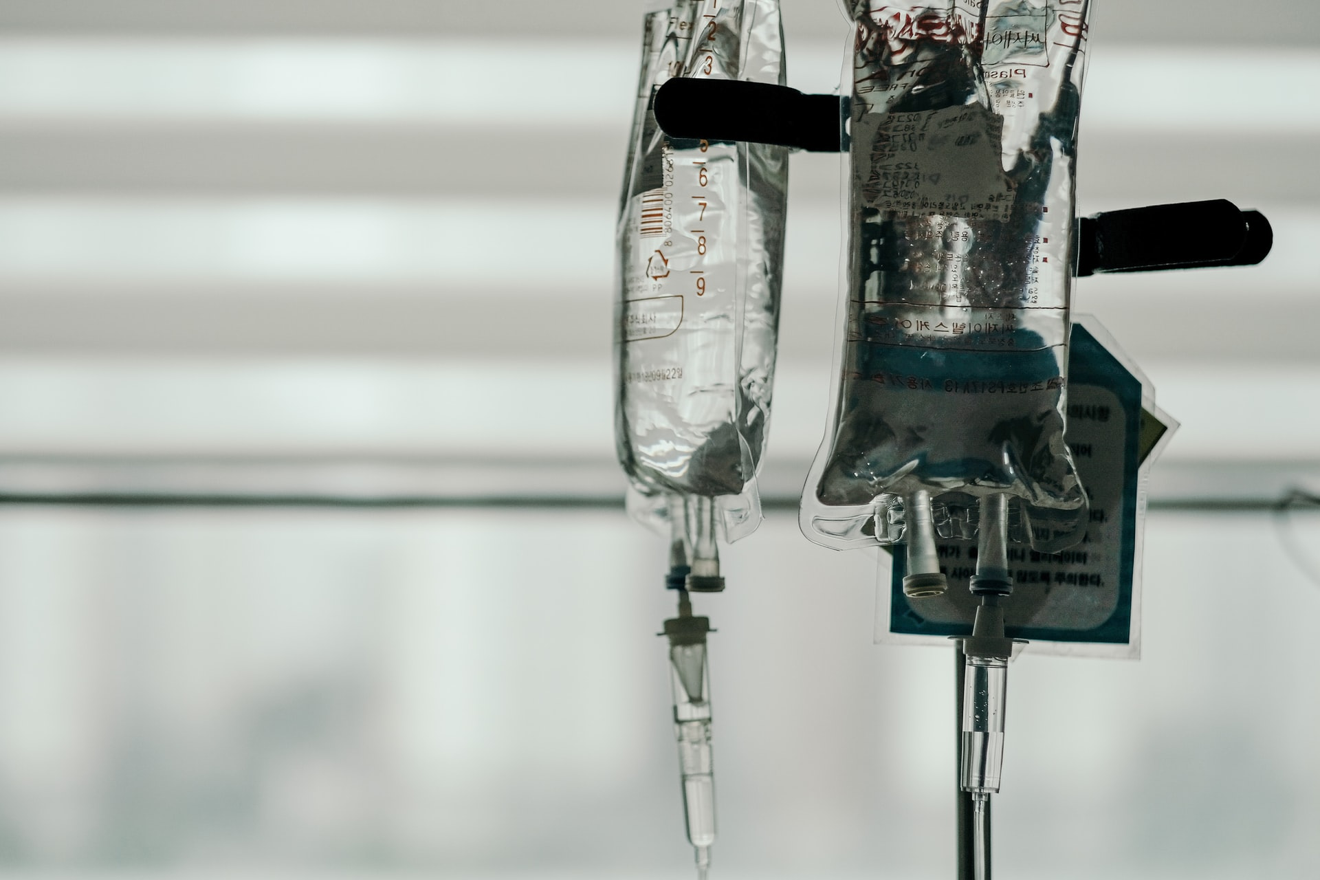 This image shows a few drips hanging in a hospital.