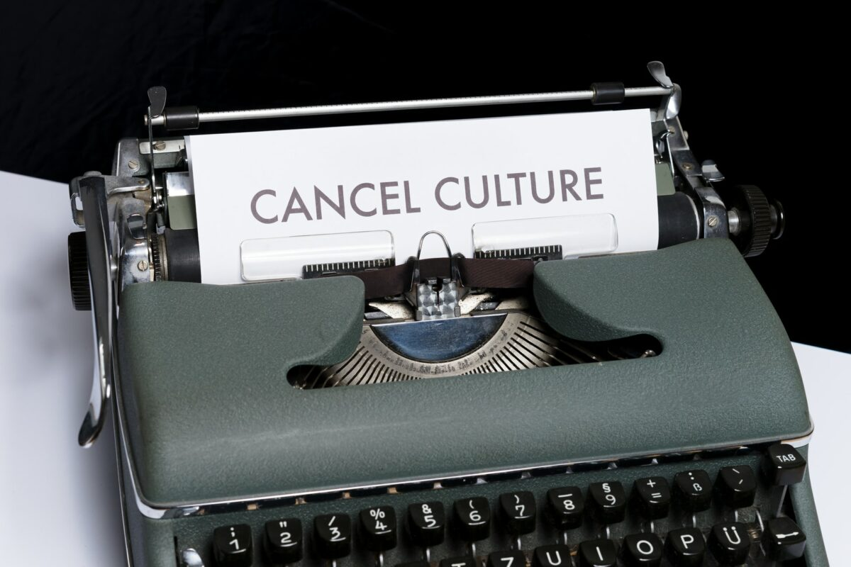 This image shows a typewriter with the paper reading 'cancel culture'