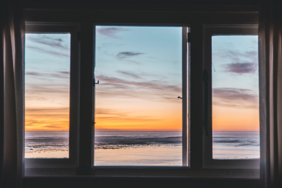 This image shows windows looking out to a sunset.