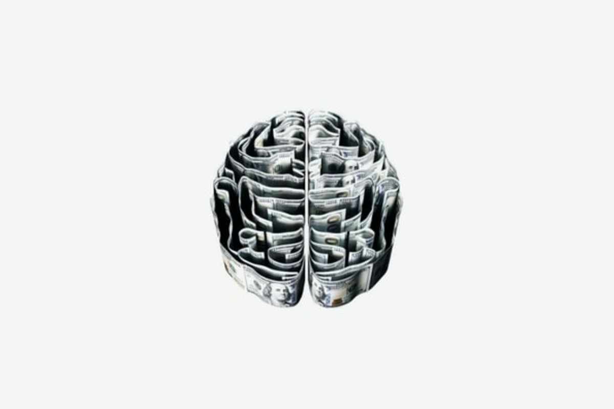 In this image, a metal replica of the human brain is i the centre of a white background.