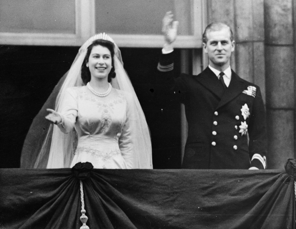Prince Philip and the Queen are pictured here waving from the balcony on their wedding day on 20th November 1947.