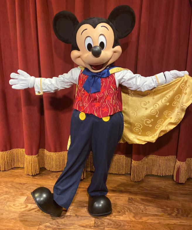 This image shows the character Mickey Mouse at a meet and greet.