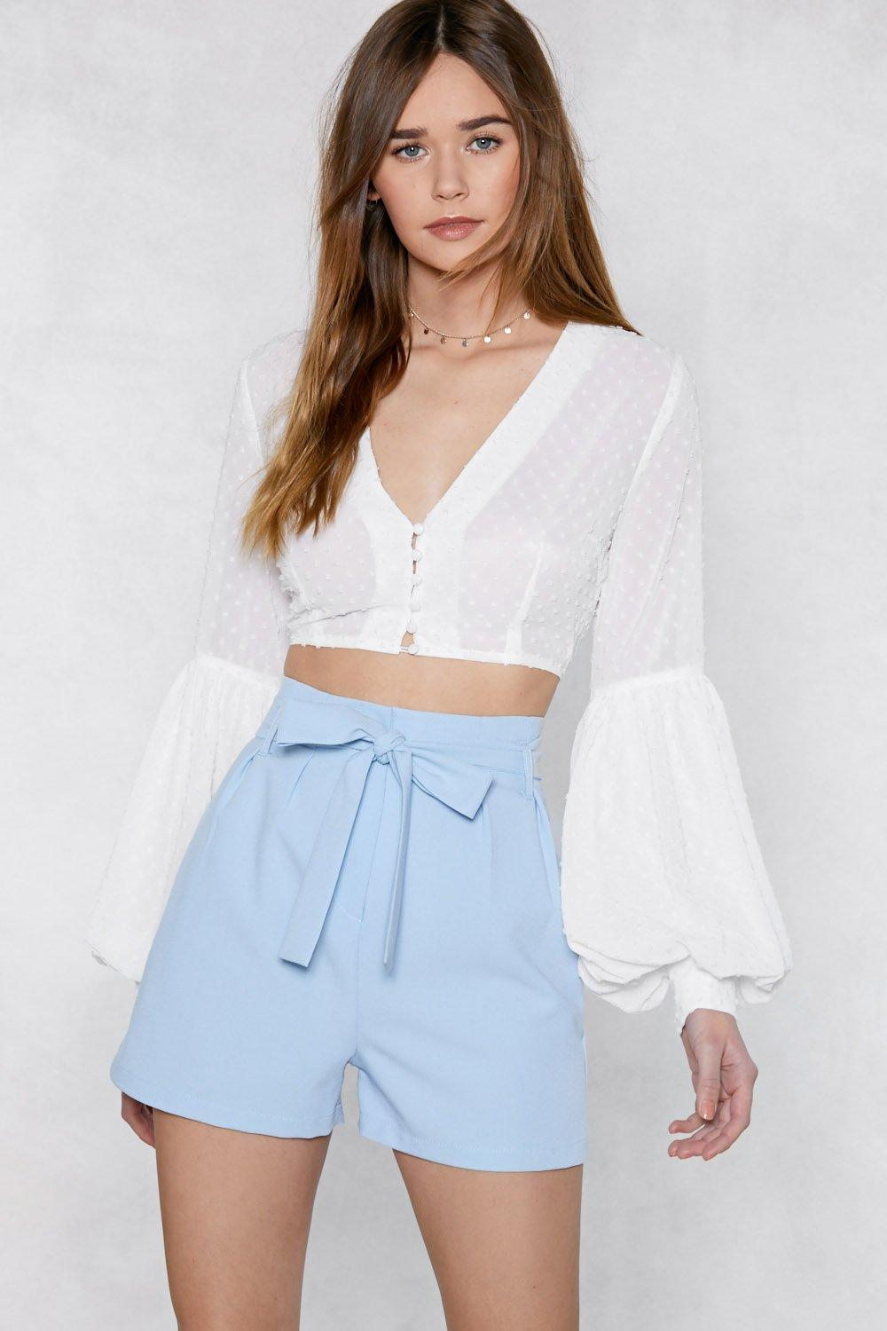 Promise to Tie Tailored Shorts are pictured here in a light blue colour.