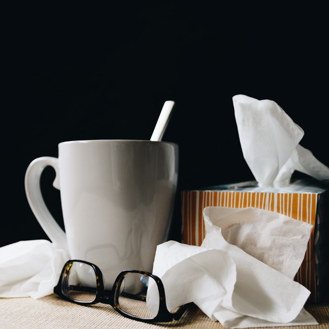This image shows a mug, tissues and glasses.