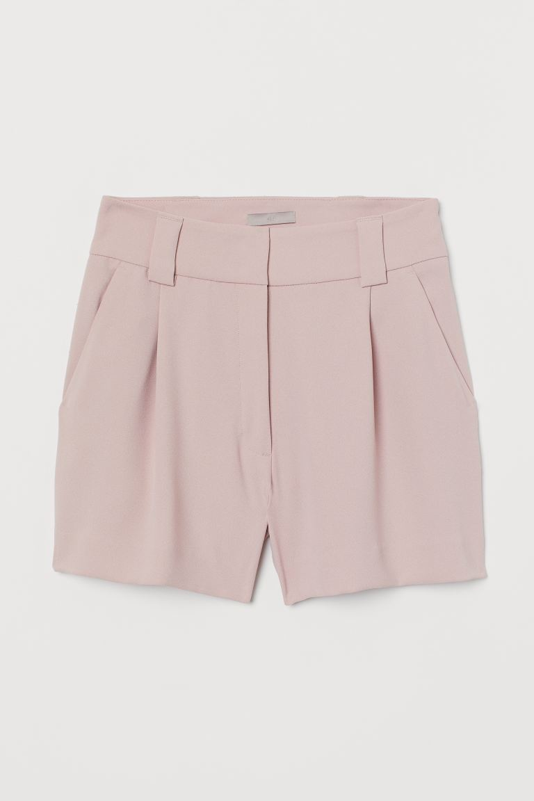 H&M pink tailored shorts are shown here.