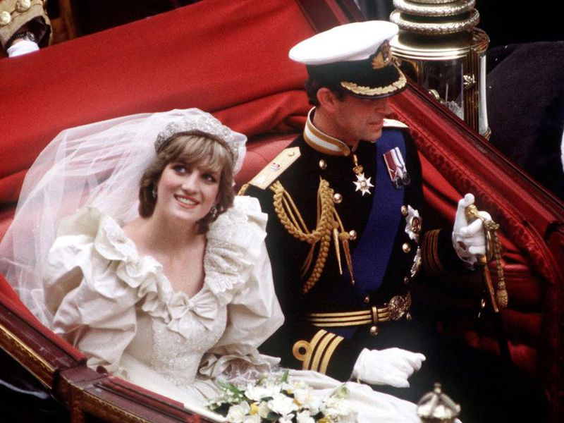 Princess Diana is pictured here on her carriage on the day of her wedding to Prince Charles.