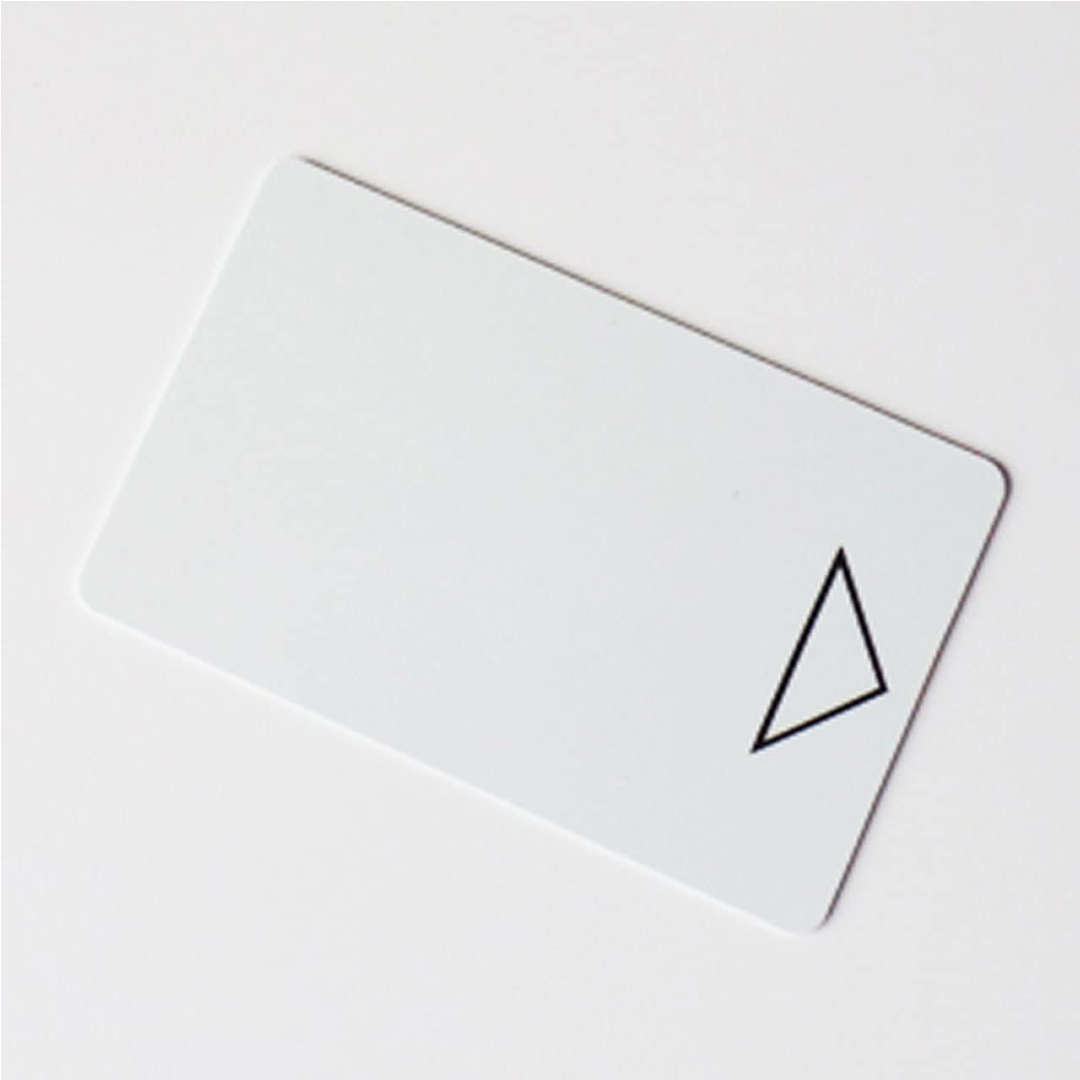 A plain white hotel key card is pictured here.
