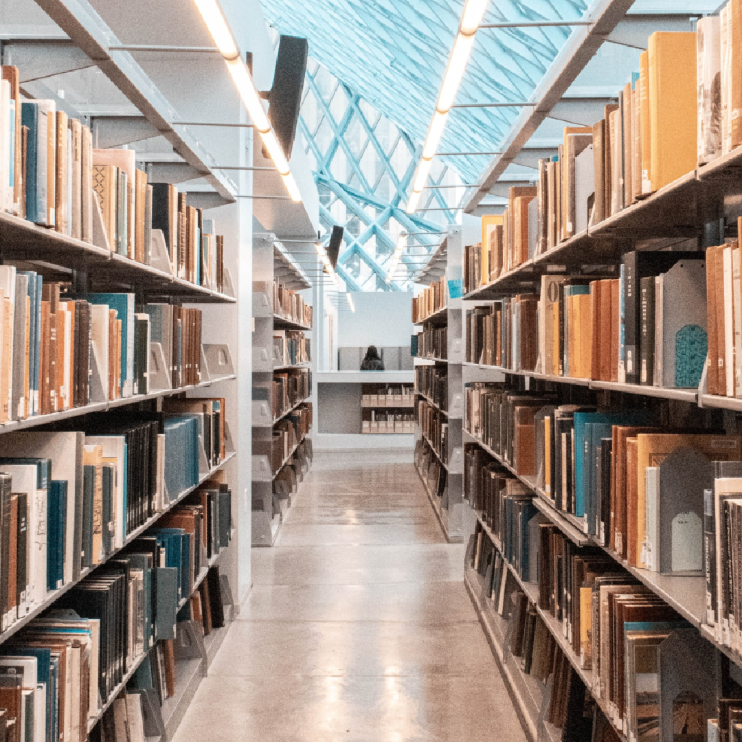 This image is of a library with rows of books on each side.