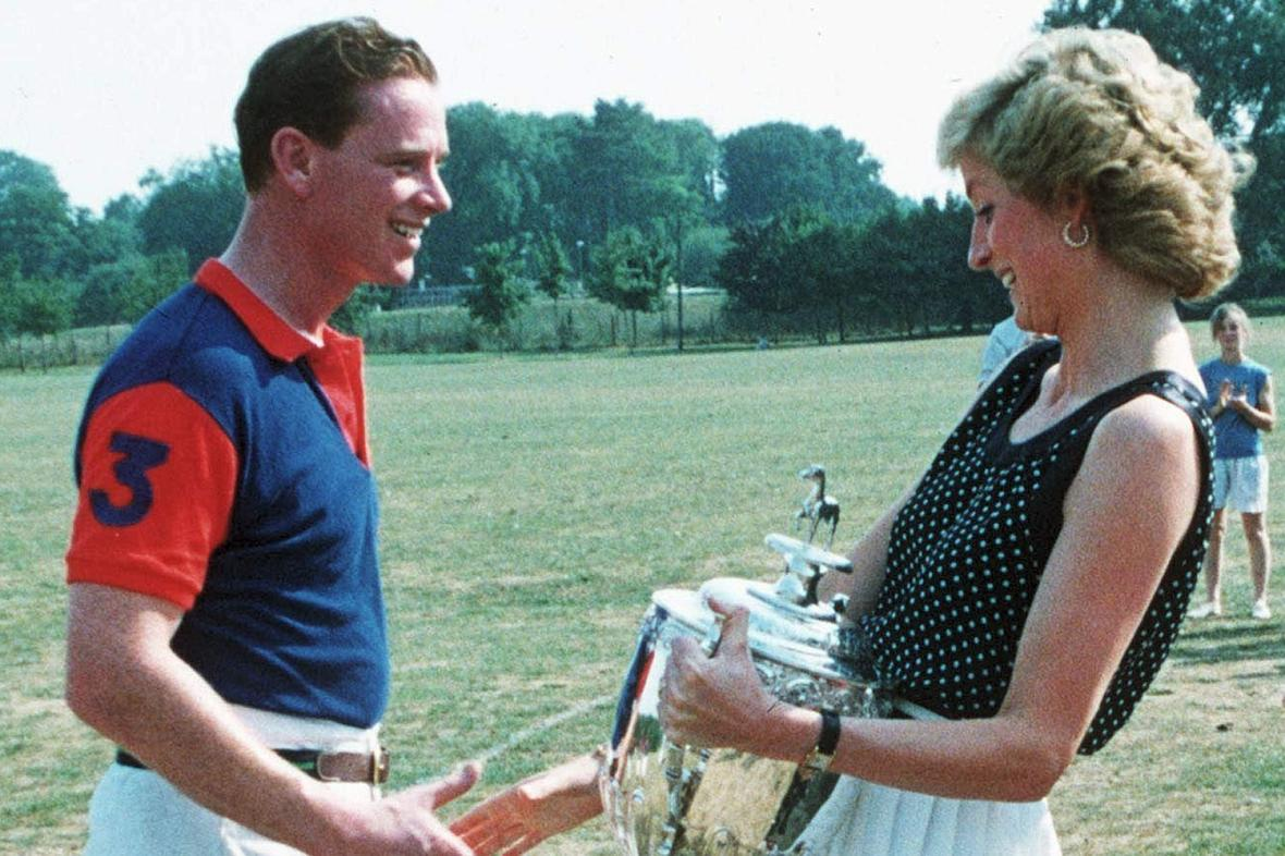 Princess Diana is pictured here handing a trophy over to her partner, James Hewitt.