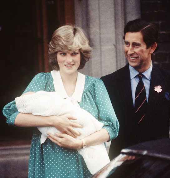 This image shows Princess Diana holding her newborn, Prince William alongside her husband, Prince Charles outside of the Lindo Wing of St Marys Hospital.