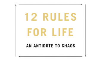 This image shows a white box with gold writing reading '12 rules for life' in bold font. Underneath it reads the rest of the title 'an antidote to chaos' in black smaller bold font with black arrows squaring the writing off in the centre of the photo.