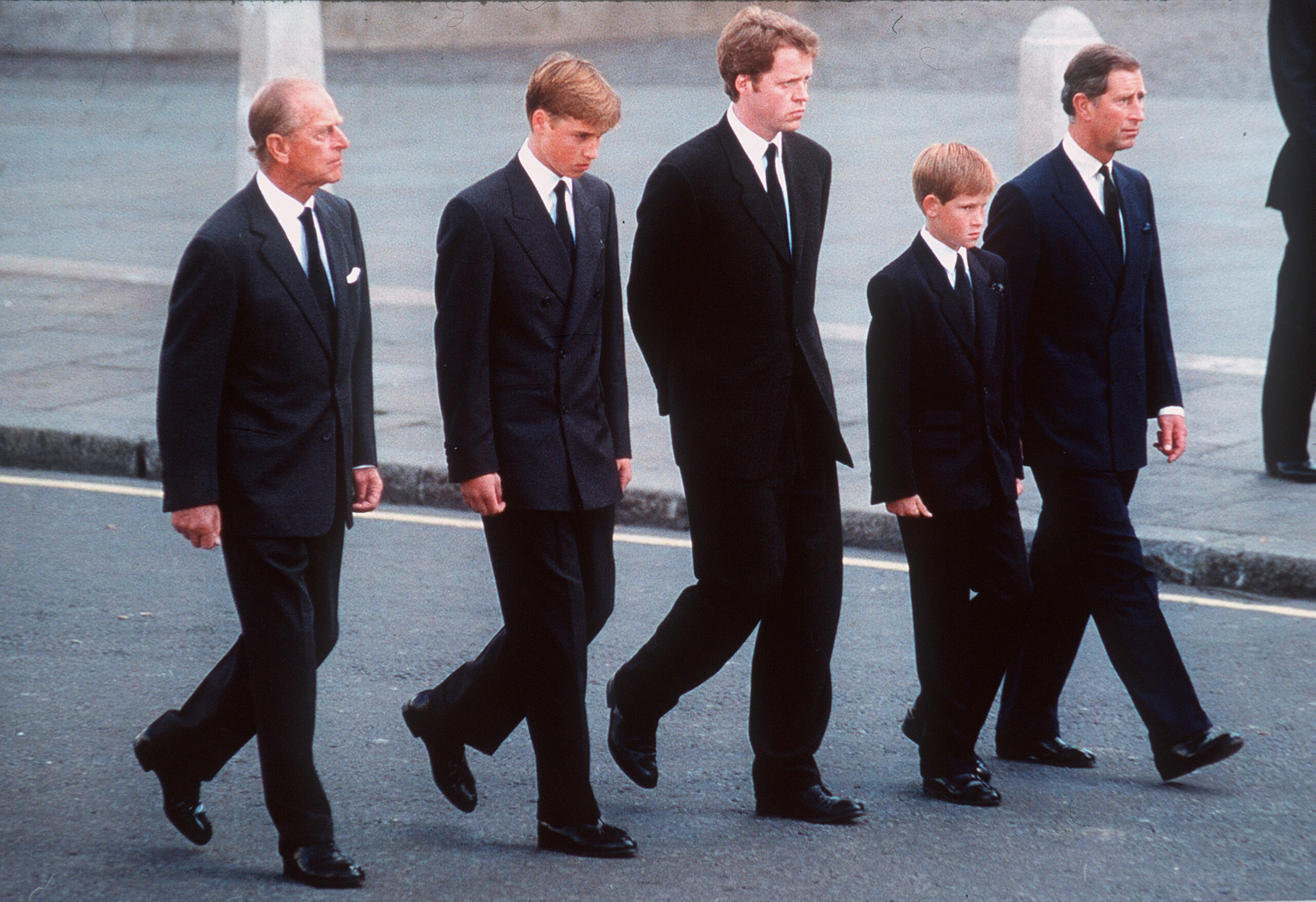 Prince Philip, the Duke of Edinburgh, Prince William, Earl Spencer, Prince Harry and Prince Charles, the Prince of Wales follow the coffin of Diana, Princess of Wales, London, England, September 6, 1997. The funeral took place seven days after she was killed in an automobile accident in Paris. Members of the royal family walked in the procession behind the coffin, as did 500 representatives of the charities associated with the Princess.  At least a million people lined the streets of central London to watch the procession from Kensington Palace to Westminster Abbey.