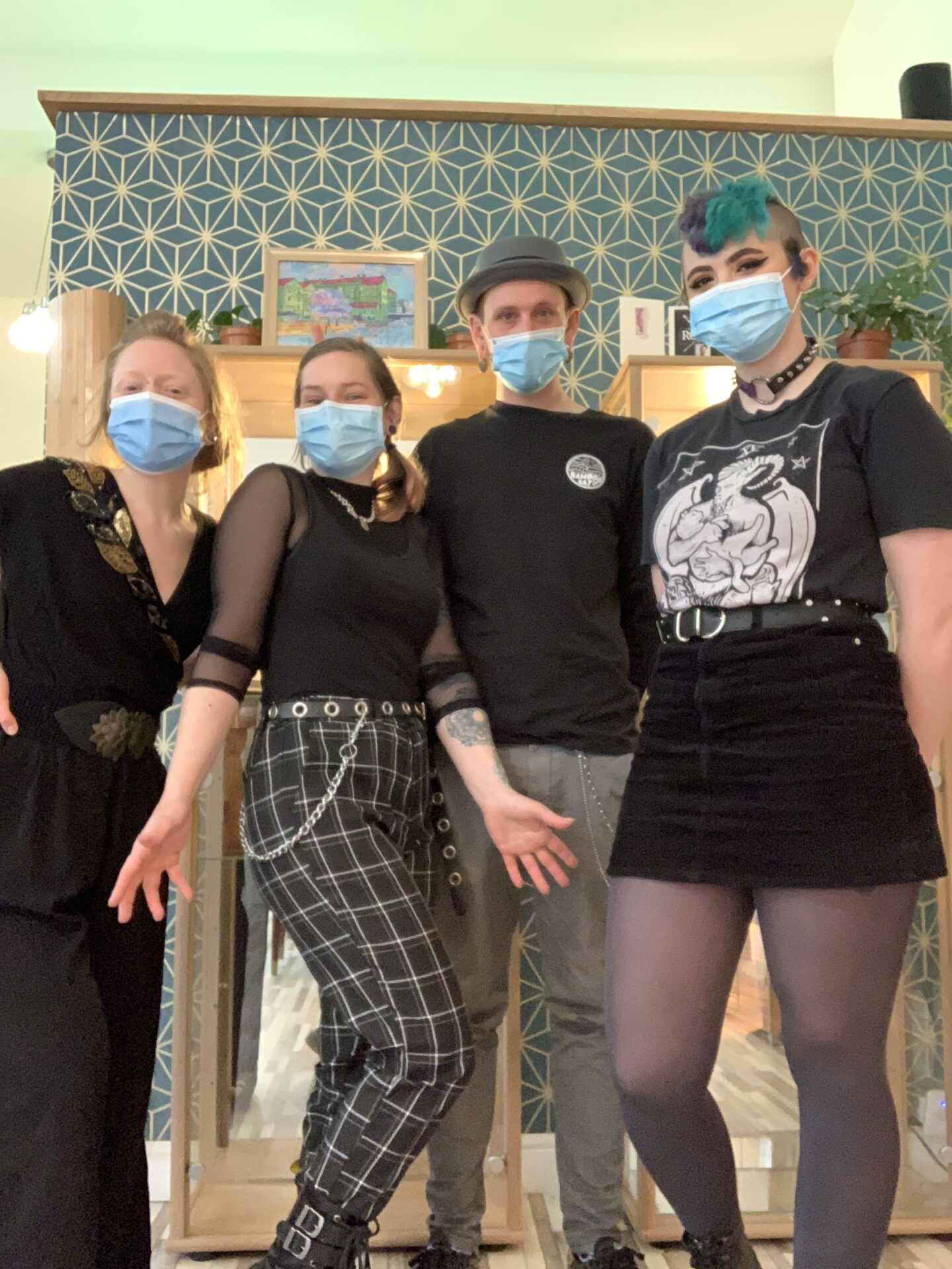In this photo, all the workers at Rogue Piercing are stood next to each other and posing for the photo.