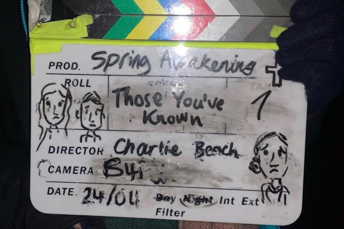 This image shows the clapperboard from the set of spring awakening, a musical production by the university student of Norwich.