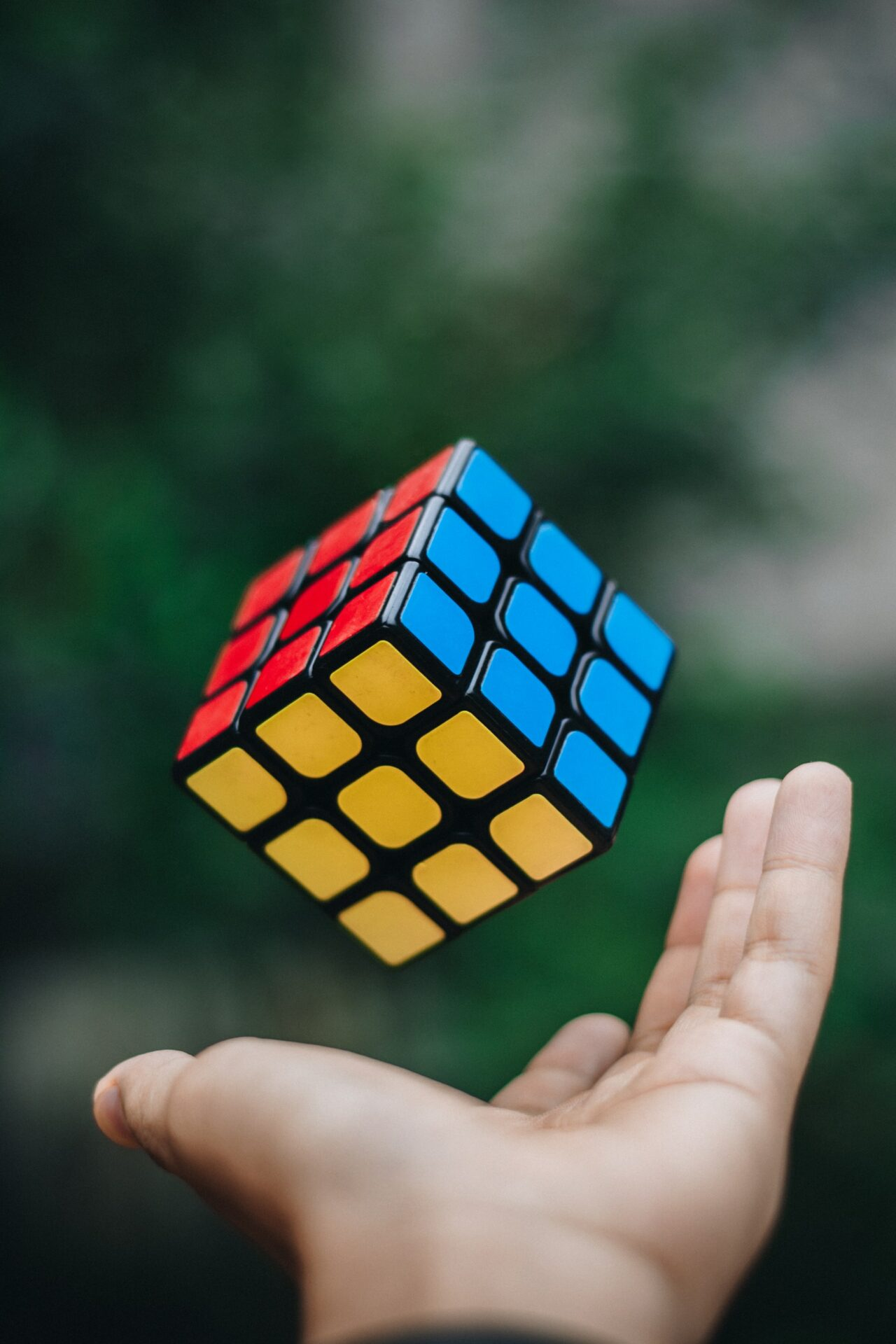 This image is of a Rubix Cube as it has been thrown in the area. The Rubix cube is in perfect formation, not jumbled.