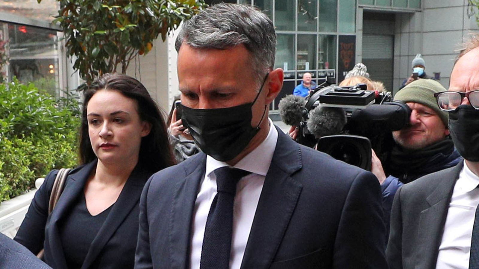 Ex-footballer and the Wales manager, Ryan Giggs is accused of assaulting two women. This image shows Giggs as he walks to court.