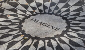 This image shows a decorated floor paving, in the centre reads 'imagine'.