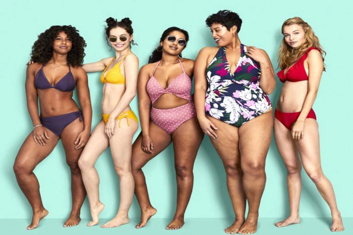 This image shows a line-up of women, all different shapes and sizes, wearing swimwear.