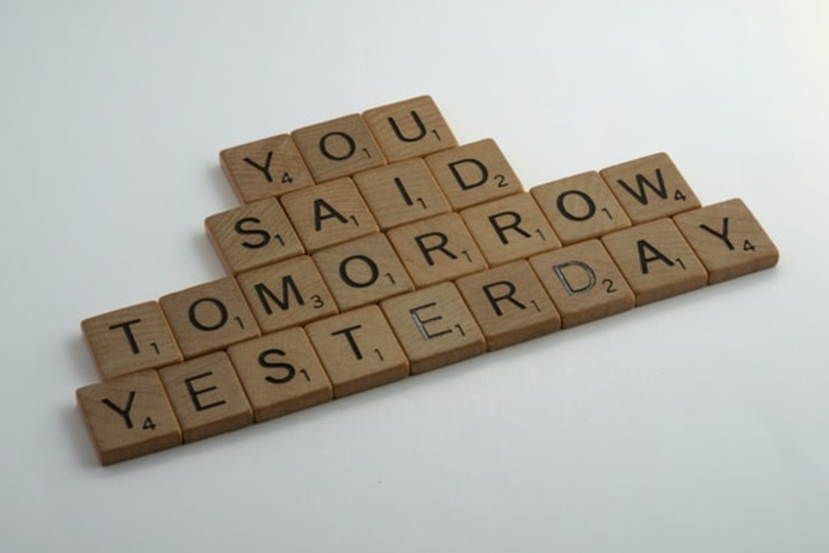 """In this image, scrabble pieces spell """"You said tomorrow yesterday""""."""