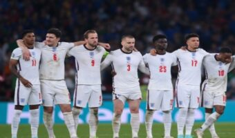 This image shows the England football team stood next to each other at the Euro 2020 final.