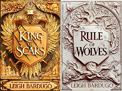 This is an image of the King of Scars book series. The book on the left is gold with wings coming out the sides of a scratched shield. The title of the book in on top of the shield. All of it is in gold. The second book is on the right and is similar to the first book apart from instead of wings coming out of the shield it is a tree, the book is white and the writing is in maroon.