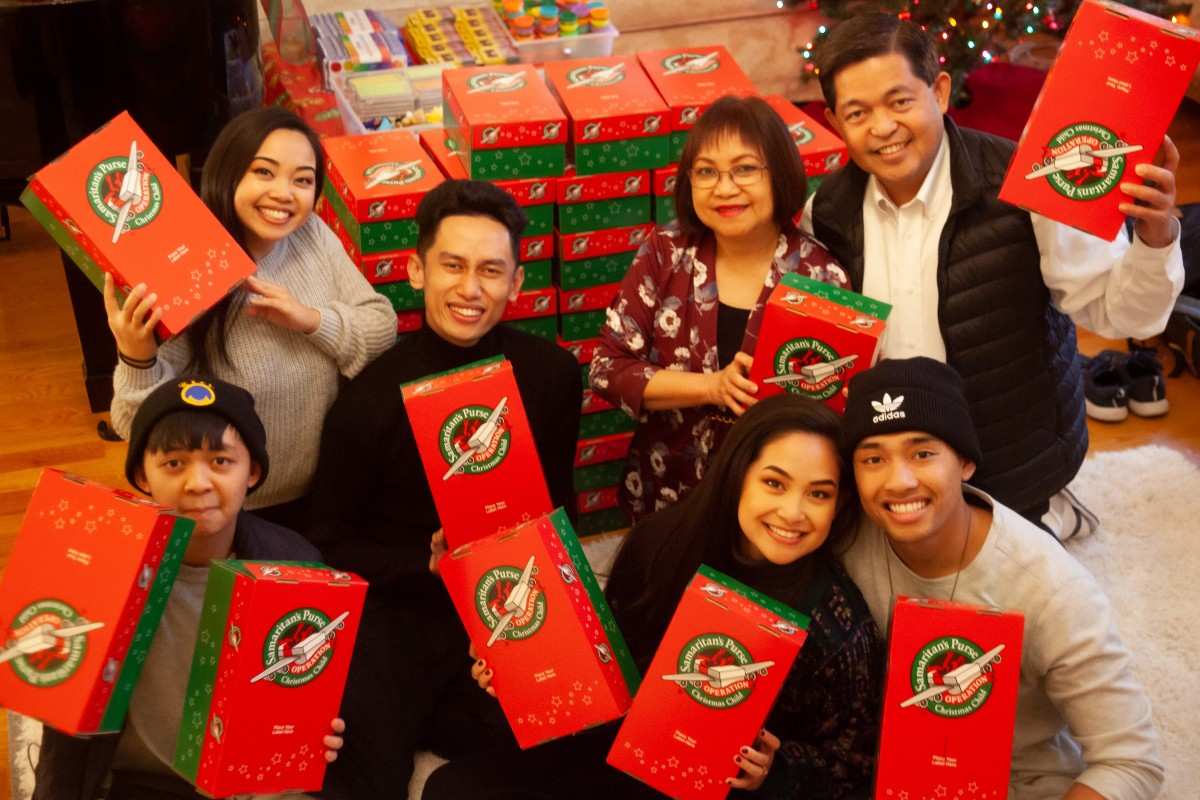 This is a Christmas themed image from Belugabee. They are all sat holding show boxes that they send off to children.