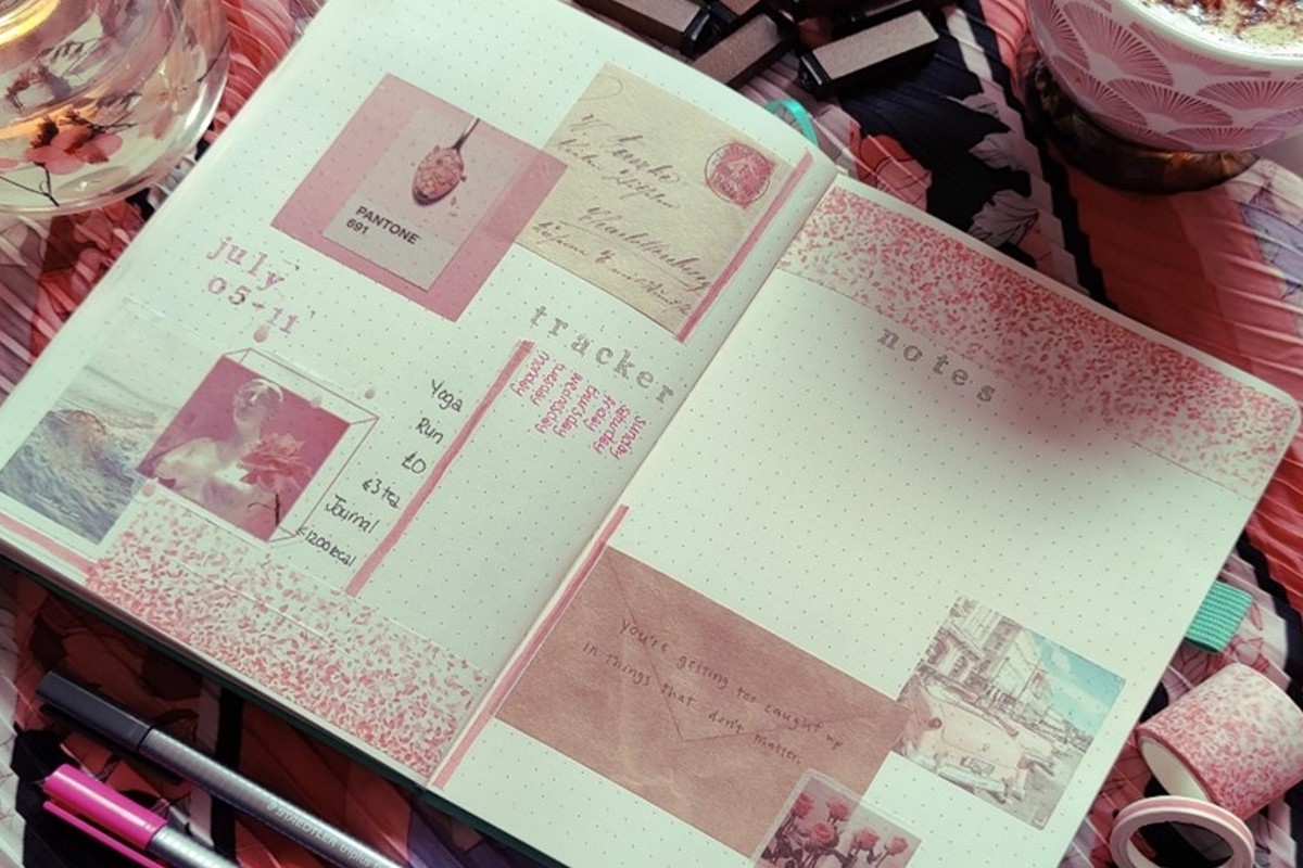 This is an image from Jess' Instagram. It is a spread from one of her journals, the main colour scheme is pink and the journal has multiple drawings and things stuck on it.