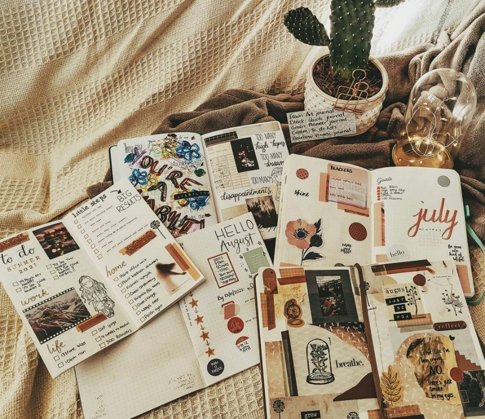 In this image, Jess has laid out all of her journals, wide open, on a white sheet and taken a picture of them.