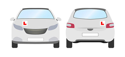 In this image there are two cars, one facing forward the other facing backward. Car 1 has an L plates on the right hand side of the bonnet and car 2 has an L plate on the left hand side of the boot door.